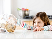 Girl reaching into cookie jar