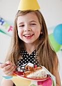 Child at Birthday eating cake