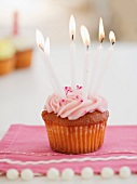Lit candles on cupcake