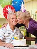 Senior couple celebrating birthday