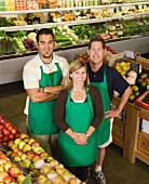 Workers posing in produce section
