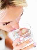 Blond woman drinking a glass of water