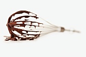 Wire whisk on white background