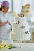 Wedding cake, pastry chief in background
