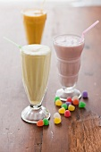 Selection of milk shakes and colorful jelly beans