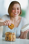 USA, New Jersey, Jersey City, woman eating cookies