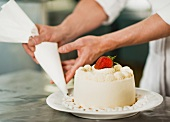 Pastry chef decorating cake