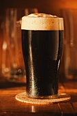 A glass of dark beer