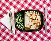 Close up of TV dinner on checked table cloth