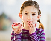 Young girl eating a cookie