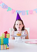 Portrait of girl (6-7) celebrating birthday