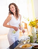 Woman pouring wine to glass