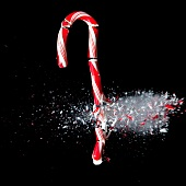 Studio Shot of candy cane crushed by bullet