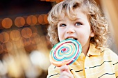 USA, California, Los Angeles, Boy (4-5) holding lollipop and looking away