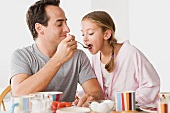 Father with daughter having breakfast