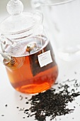 Earl Grey tea with a teabag in a glass jar