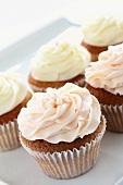 Several buttercream cupcakes