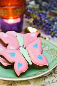 Butterfly cookies in a tea cup with saucer. Tea light. Lavender.