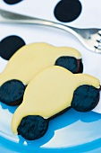 Yellow 'car' cookie on a plate with a fork
