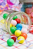 Colorful gum balls in a glass jar
