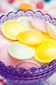 Flying saucer candies in a glass dish