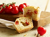 Muffin filled with tomatoes, mozzarella and ham