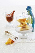 Sandwich triangles in a cheese cover with a toy dinosaur