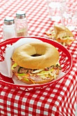 Bagel with meat and vegetables