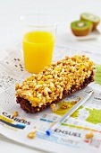 Chocolate muesli bars and orange juice