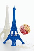 Eiffel tower with a red candy apples