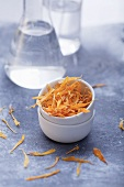 Dried marigold petals in a little bowl