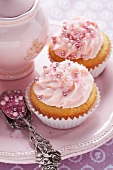 Pink cupcakes with sugar pearls