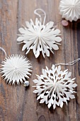 Christmas decorations: paper stars on a wooden surface