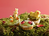Muffins with marzipan decorations for Easter on moss