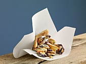 Kaiserschmarren (sweet cut up pancakes) with blueberries in paper
