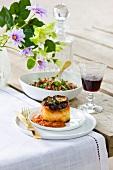 Vegan moussaka, salad and wine