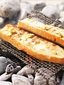 Garlic baguettes on the barbecue