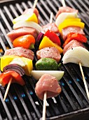 Raw shish kebab skewers on the barbecue