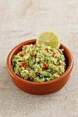 Classic Guacamole in a Glass Bowl; Fresh Avocados