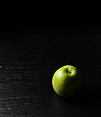 Artistically lit, green apple