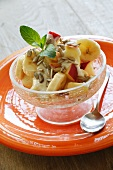 Yogurt muesli with apple, bananas and sunflower seeds