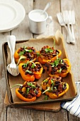 Yellow peppers stuffed with ground beef and kidney beans