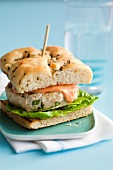 Chicken burger with tomato mayonnaise on focaccia