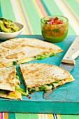 Quesadillas with cheese, spring onions and chili peppers