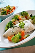 Chicken breast with vegetables and herb sauce