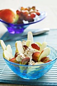 Fruit salad with pears, apples, grapes and yogurt sauce