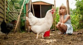 Germany, Brandenburg, Girl on hen farm