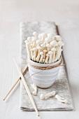 Bowl of shimeji mushrooms with chopsticks on napkin