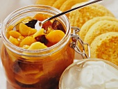 Apricot compote with yogurt and little pancakes