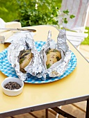 Baked potatoes (foil wrapped) with herbs